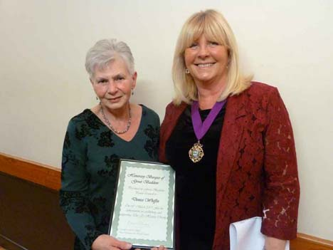 Photo of the Deputy Mayor, Cllr Christine Garrett, presenting Denise Whiffin with her Honorary Burgess award